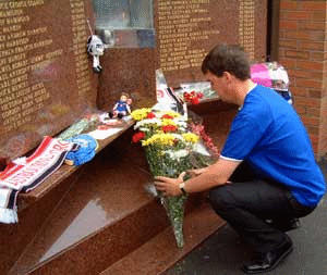 Liverpool and Everton fans pay tribute at the Hillsborough memorial