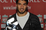 Luis Suarez is presented with the Standard Chartered Player of the Month award for August.