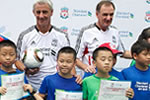 Phil Thompson and Ian Rush attend a Standard Chartered soccer clinic in Guangzhou.